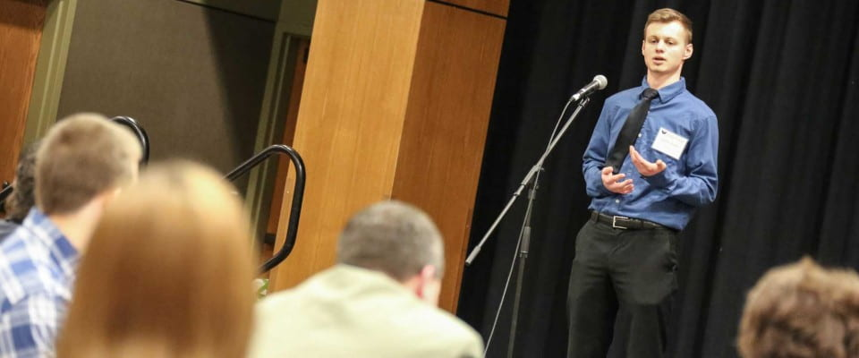 Student in Elevator Pitch Competition During Business Week