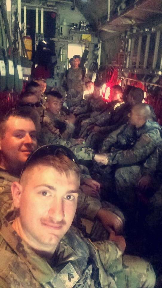 UW-Green Bay student and member of the National Guard, Nick Cravillion, takes a selfie with his unit. They are heading to Florida to support in hurricane relief efforts.