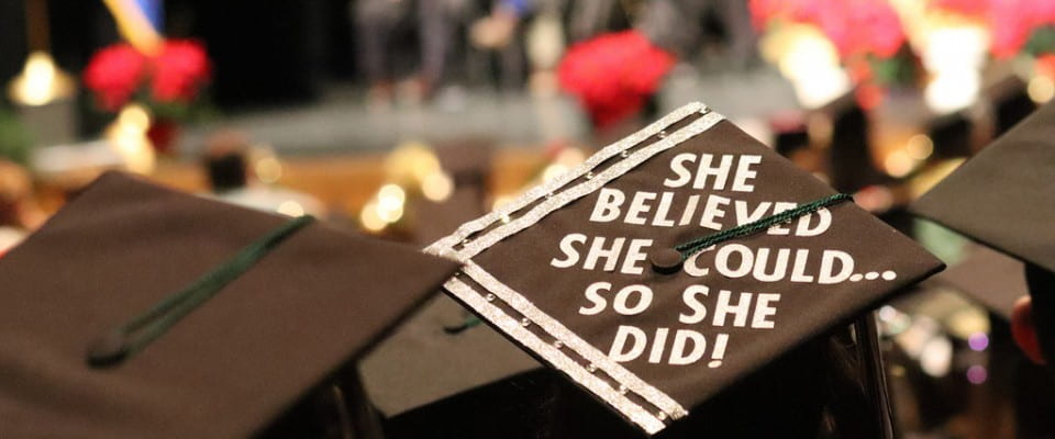 "Decorated grad cap ""She believed she could so she did!"""
