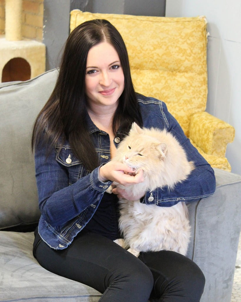 Elizabeth Feldhousen holding an orange cat
