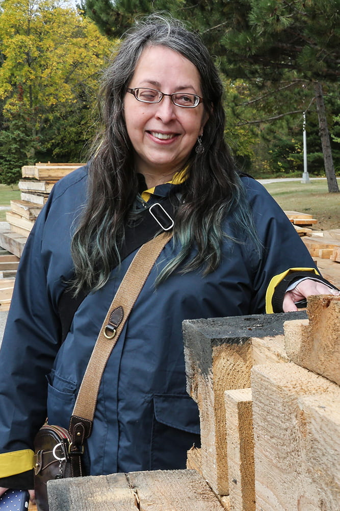 Prof. Sherman with Viking Long House beams