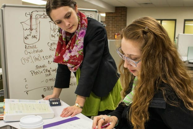 Student tutor Gillian Evanoff (left) helps former GPS program participant (now a teaching assistant) Alison Klein prepare for a chemistry final.