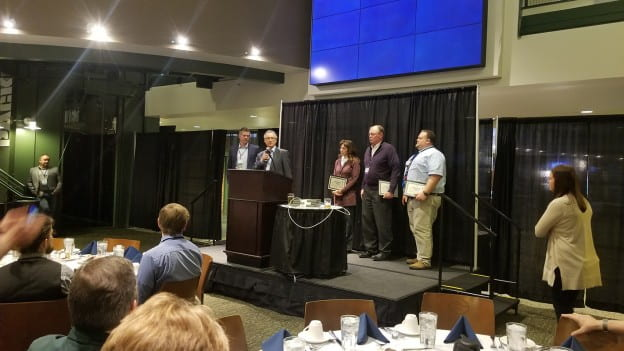 Accepting the 2018 Watershed Hero Impact award for UW-Green Bay was Kevin Fermanich, along with high school partners Lynn Terrien, Green Bay Southwest; Charlie Frisk, Luxemburg-Casco (retired) and Ryan Marx, Appleton East.