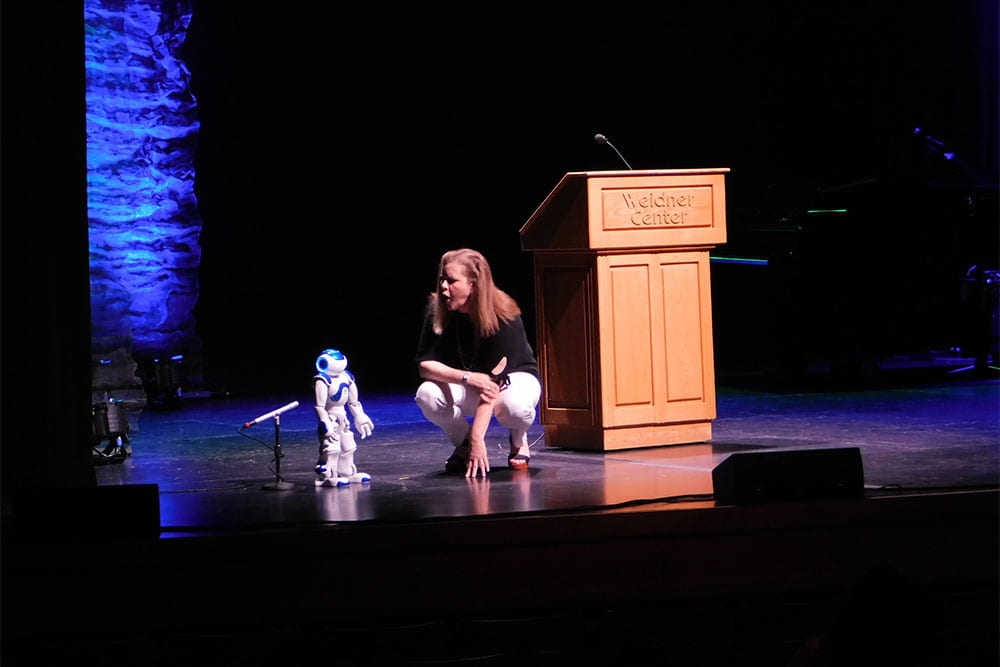Kelli Strickland talks with UWGB robot on the Weidner Center main stage