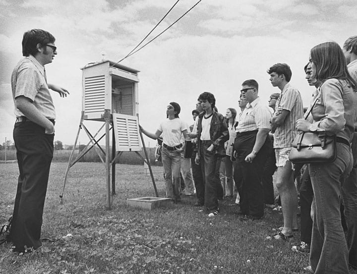 Professor Joseph Moran and a group of students at the Weather Station ca. 1970-1979