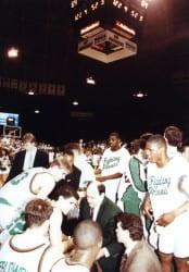 Mike Heideman in huddle with Phoenix Men's Basketball