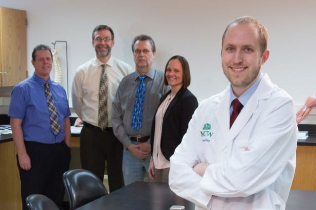 Matt Torbenson is grateful for the UW-Green Bay MCW Green Bay partnership that made his transition from college student to medical student seamless. In back: left to right, UW-Green Bay Prof. James Marker, MCW Associate Dean Craig Hanke, UW-Green Bay's Prof. Uwe Pott and Associate Dean Amanda Nelson.