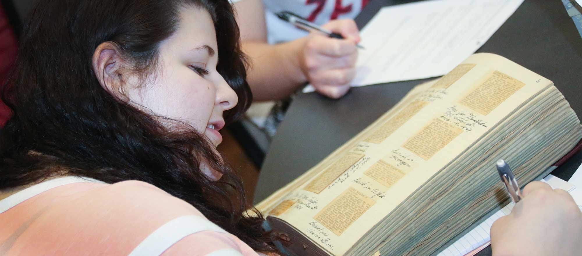 Student working with archives collection