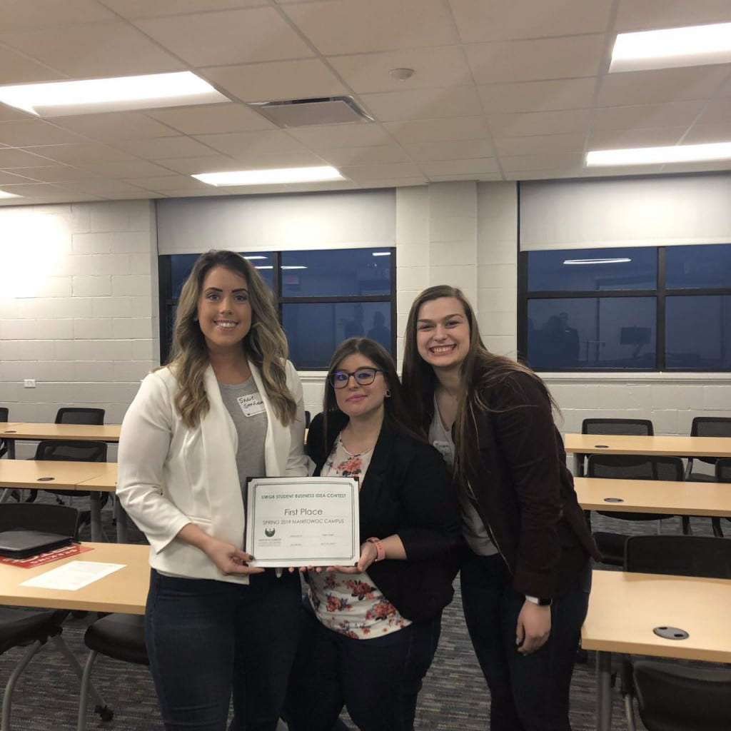 Spring 2019 UW-Green Bay, Manitowoc Campus Student Business Idea Contest winners Brianna Chase, Sadie Stiefvater and Allie Torgeson with their certificate