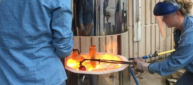 Intro to ceramics students raku firing.