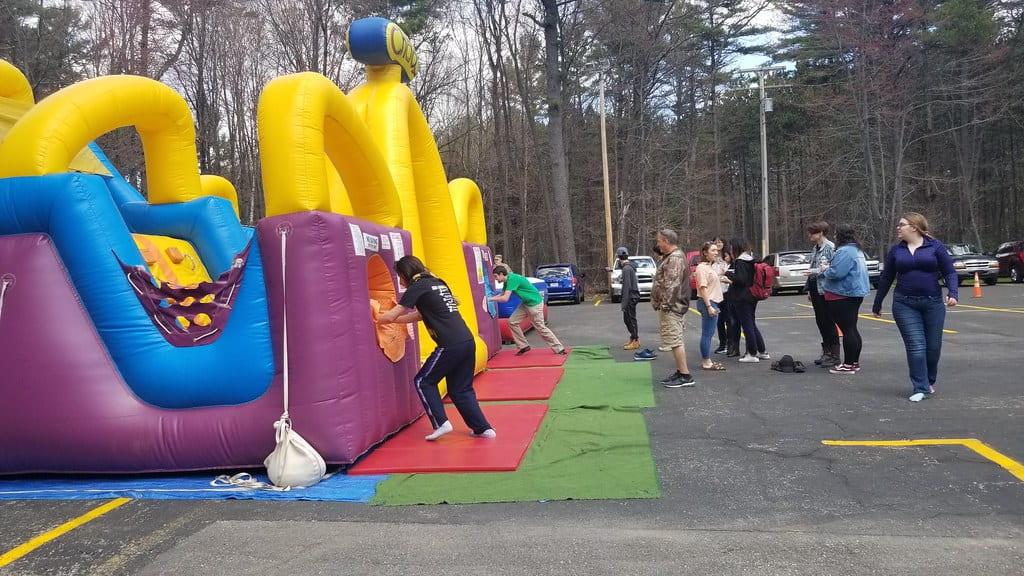 Inflatable bounce houses at the Marinette Campus End of the Year Bash