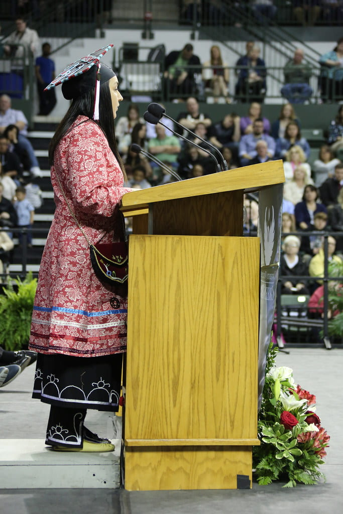 Graduating Class Speaker Yuntlekalau McLester in traditional dress