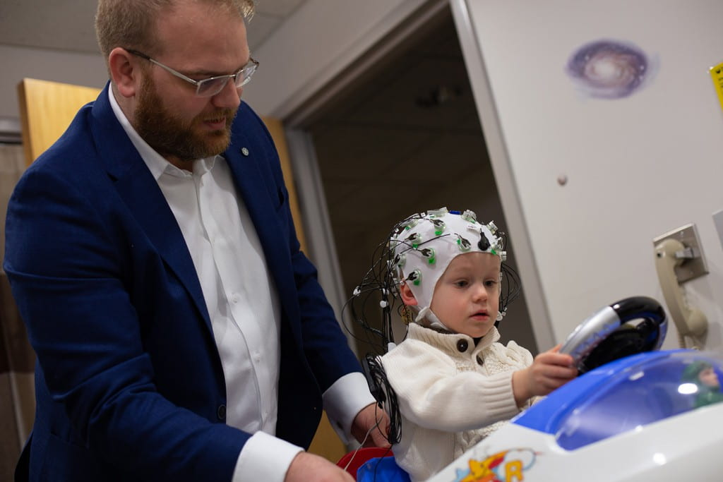Psychology faculty Jason Cowell studys child's brain activity