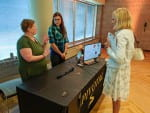 """UW-Green Bay students Carol Brehmer, left, and Ebanie Schmidt explain their innovation """"PIVOTAL""""—a belt designed specifically for outdoor hobbyists and blue-collar workers—during the WiSys Innovation Showcase during WSTS at UW-Stout."""