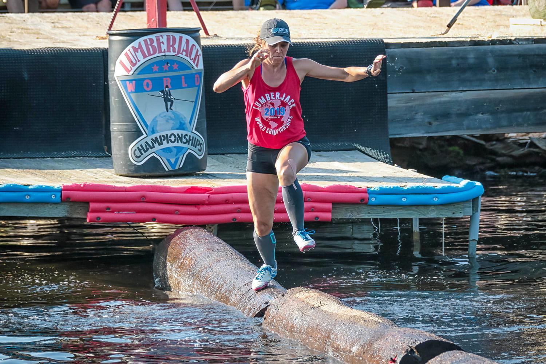 Katie Rick Burke running across floating logs