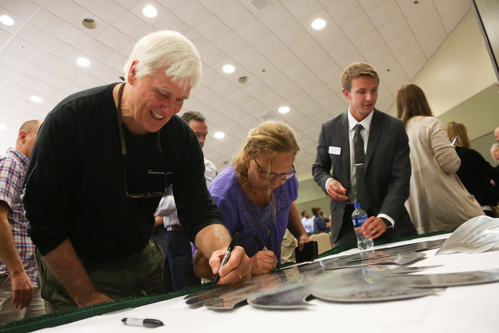 Signing aliegiance to the new mission on the stainless steel phoenix