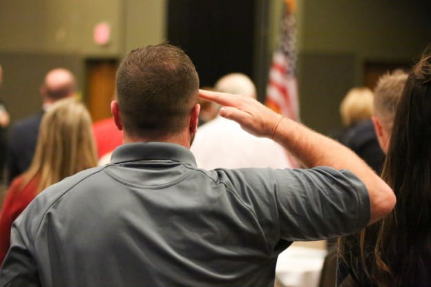 Saluting the flag at the UW-Green Bay Veterans Day Reception