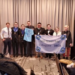 Photo Credit: Nick Blasczyk; From left to right: Matthew Schellinger (Business Administration), Post, Hamann, chapter president Nick Blasczyk (Business Administration), chapter officer Michael Ninham (Business Administration), chapter officer Maxwell Meyer (Undeclared), Kylie Brunette (Business Administration), and Jack Ward (Accounting).