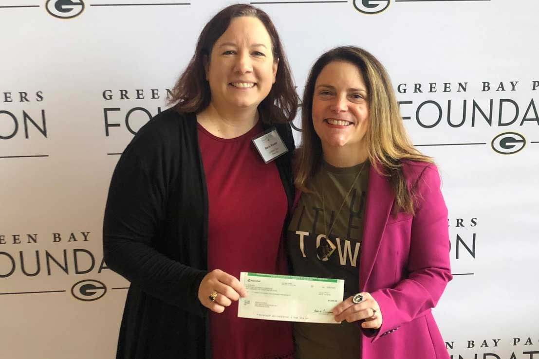 Rebecca Meacham recieves check from Green Bay Packers Founcation for UntiledTown