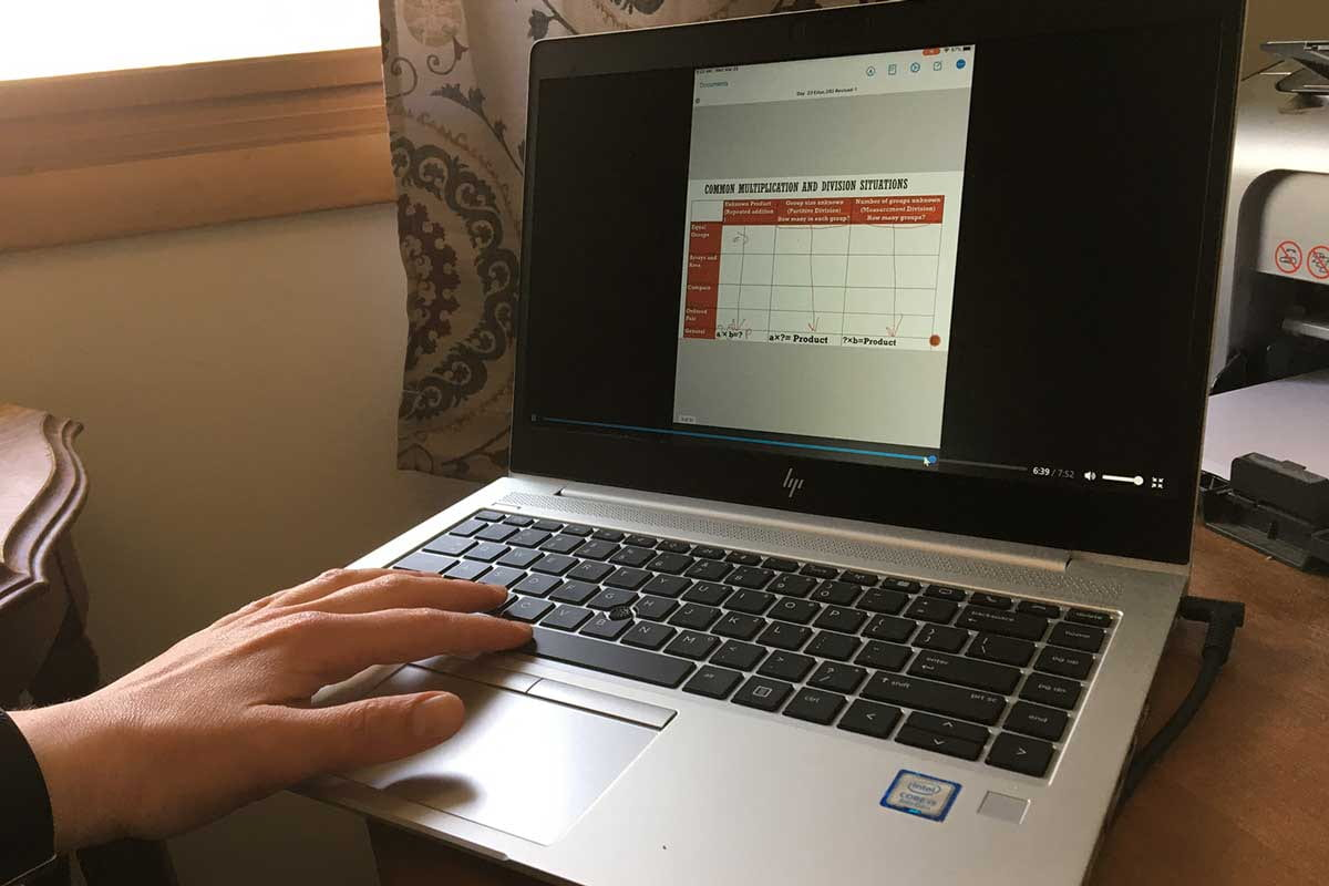 Photo of a laptop playing Mary Gichobi drawing on her PowerPoint lesson
