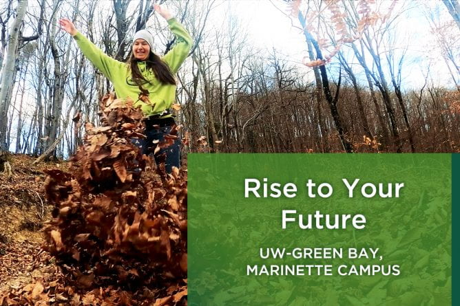 Photo of college student running through fallen leaves with her arms raised up over her head. She is laughing and smiling.