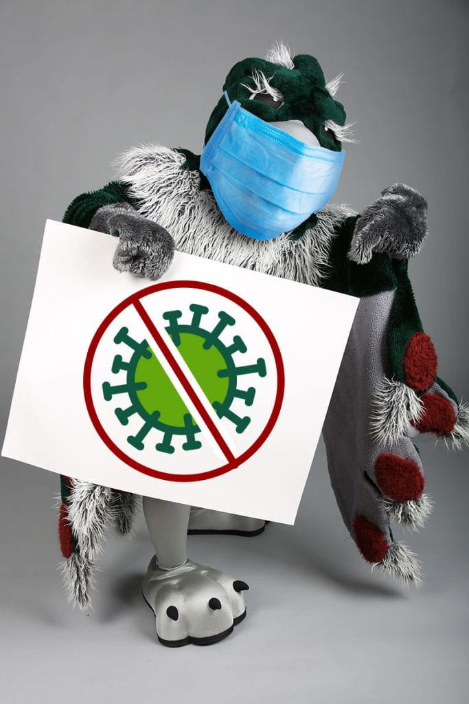 Phlash Mascot holding a sign with a stop the virus icon