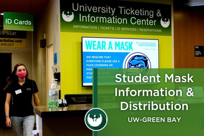 Photo of a student employee wearing a mask at working at the University Ticketing and Information Center (UTIC) in the University Union.