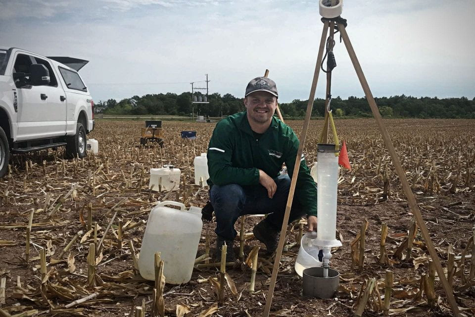 UW-Green Bay Environmental Science student Jacob Derenne studying soil health and water quality.