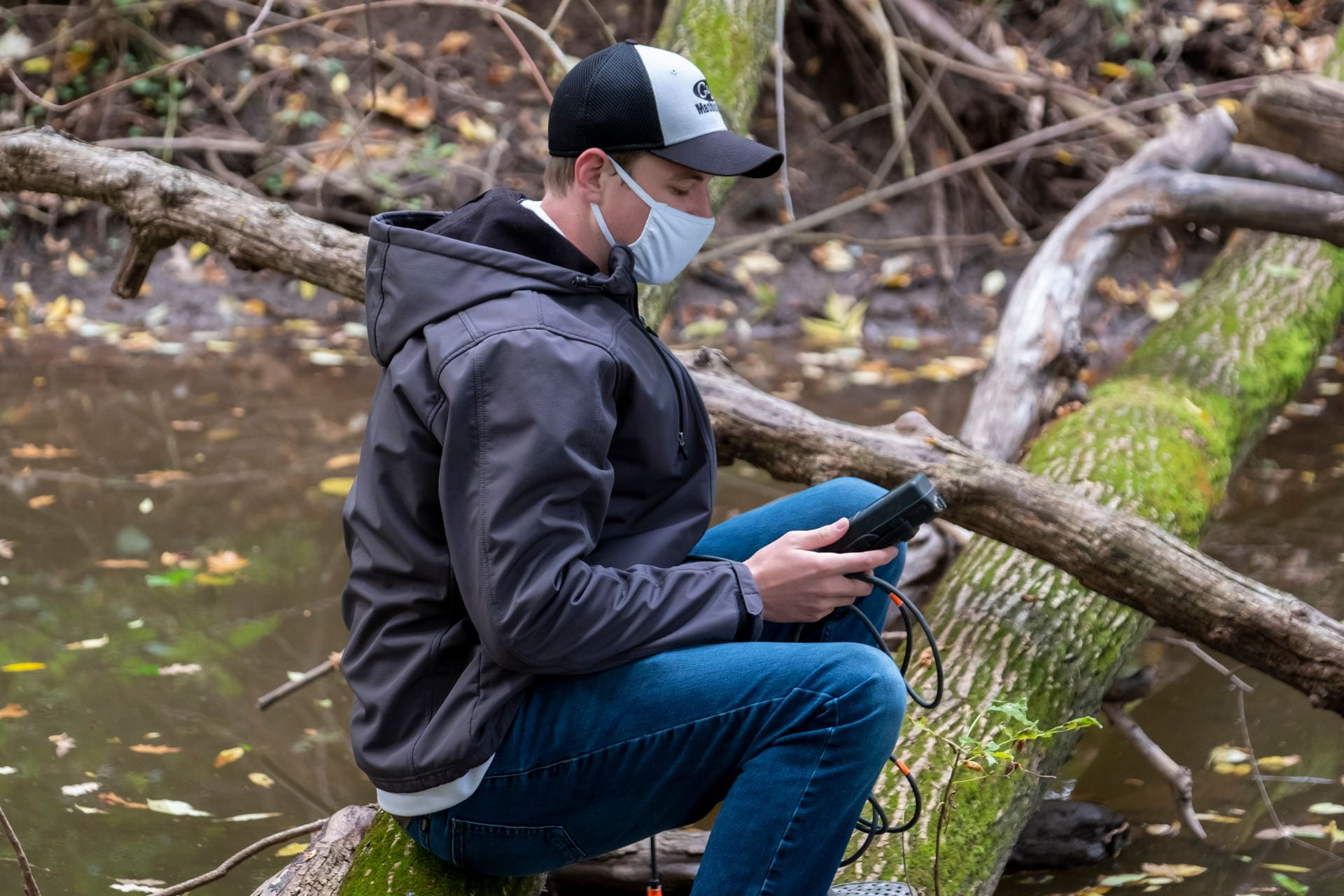 Students in Assistant Professor Kelly Deuerling's Geochemistry of Natural Waters' outdoor lab use a field instrument to test the water at the mouth of the Mahon Creek in the Cofrin Memorial Arboretum at the University of Wisconsin-Green Bay campus.