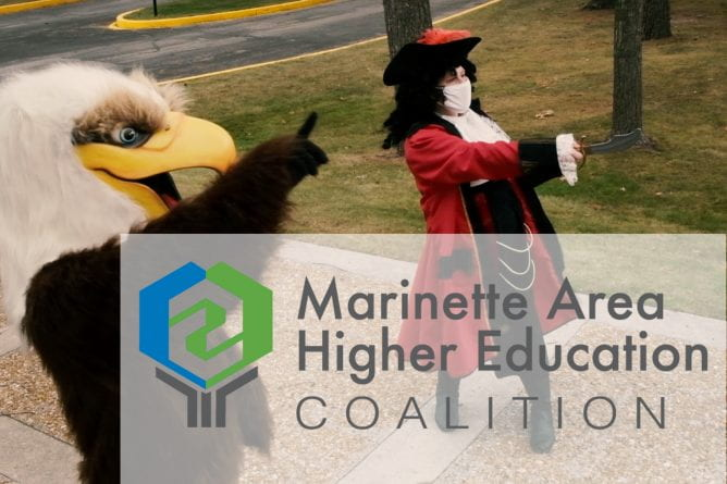 "Photo of the NWTC, Marinette mascot the ""Eagle"" posing with the UW-Green Bay, Marinette mascot, the ""Buccaneer"" at the UW-Green Bay, Marinette campus."