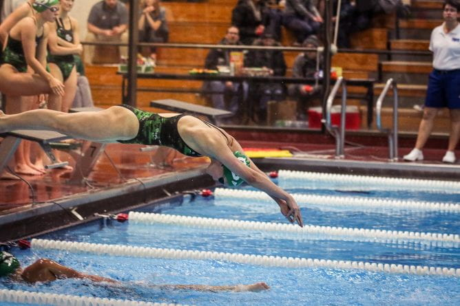 Rozalyn Stoa diving into the water during a Feb. 2019 swimming and diving team meet at the Kress Events Center pool.