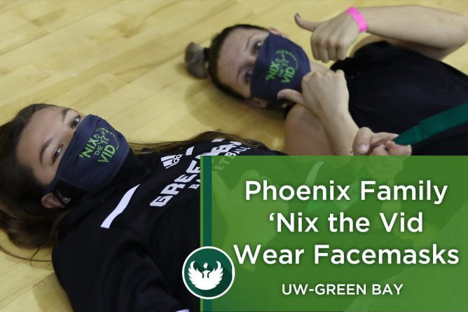 Photo of two UW-Green Bay athletes stretching while wearing Nix the Vid face masks.