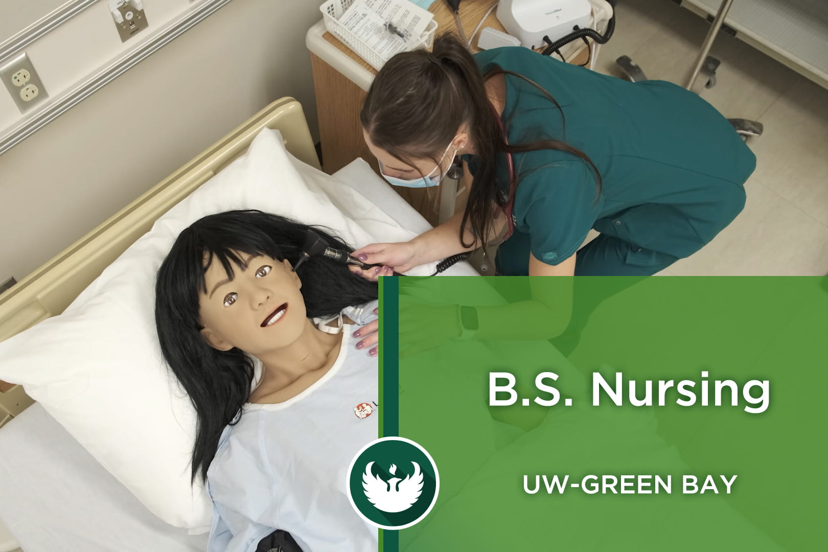Photo of a UW-Green Bay nursing student using an otoscope on a high-tech mannequin inside the new Nursing Skills Center at the Green Bay campus.