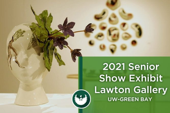 """Photo of two art pieces at the 2021 Senior Show exhibit. One piece is of a white porcelain bald head with green leaves and red wine flowers attached to the left side of the head and the other is a beautiful wood table with wood table settings. Text overlay on the photo, """"2021 Senior Show Exhibit Lawton Gallery UW-Green Bay."""""""