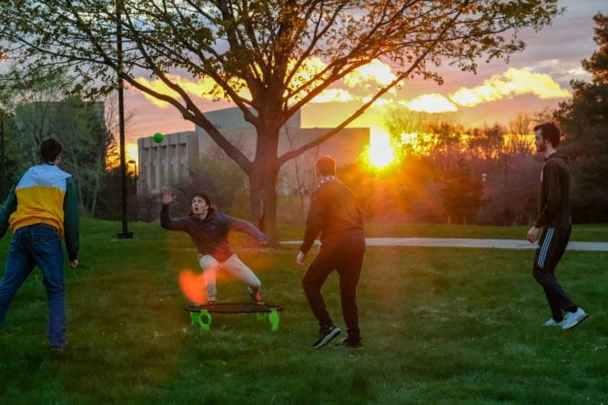 At the End of the Year Celebration students play the spike ball lawn game during sunset at UW-Green Bay's Phoenix Park on Friday, May 7, 2021.