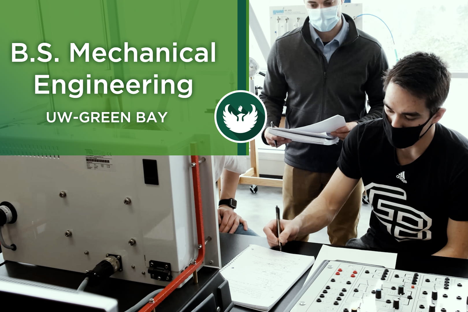 Two students set by an electronic board as they figure out calculations in one of the engineering labs inside the new STEM Center for UW-Green Bay's Mechanical Engineering Program.