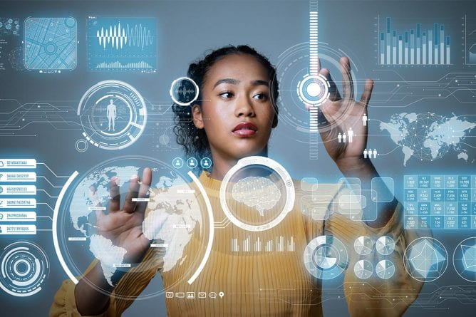 Electrical Engineering campaign image - A woman of color interacts with a transparent digital interface