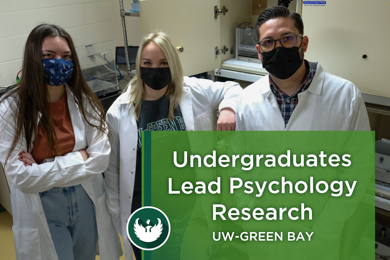 Two UW-Green Bay Psychology research students and Assistant Professor Todd Hillhouse pose for a photo inside the Pain and Addiction Neuropharmacology Lab (PANE Lab) in the Lab Sciences building at the Green Bay Campus.