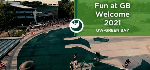 Photo of new freshman using rollers to paint the large Phoenix on the concrete turn-a-round driveway at MAC Hall Circle at the UW-Green Bay, Green Bay campus.