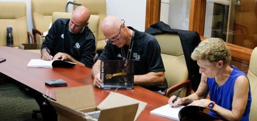 Phoenix coaches sign books