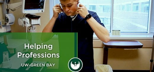"""Photo of a student putting a stethoscope in their ears as they prepare to take a blood pressure on a nursing manikin during their nursing training at UW-Green Bay. There is a text overlay with the words, Helping Professions, UW-Green Bay."""""""