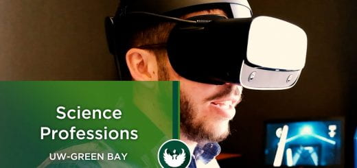 A student wearing virtual reality googles plays a video game at UW-Green Bay.