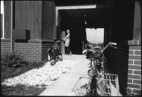 Girl and bicycles at Bay Apartment