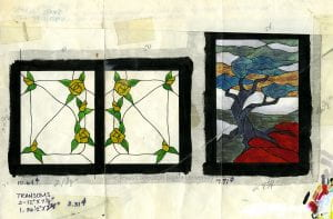 Transom designs for a residential installation. Design one is two rectangles with clear glass with yellow roses in the corners. Design two is a tree on top of red rocks with a grey background.