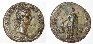 Sestertius of Nerva struck at Rome, AD 96.  Obverse: bust right of Nerva with imperial titles. Reverse: Libertas standing left holding scepter and the cap of a freed slave, LIBERTAS PVBLICA.