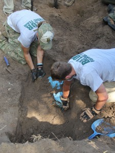 Stevie Hope, a 2014 Baylor anthropology graduate, and Cole Lindeberg, a senior anthropology major, work to exhume an unmarked grave at a cemetery in South Texas.