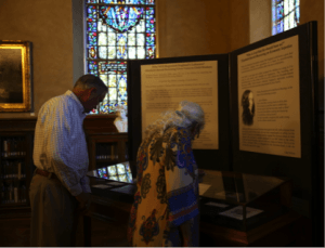 A man and woman view a museum exhibit