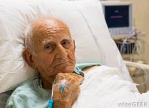 elderly-man-lying-in-hospital-bed