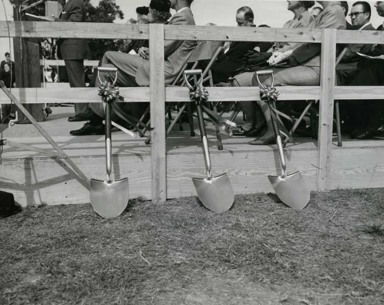 Ceremonial shovels await the beginning of festivities next to the speakers' platform.