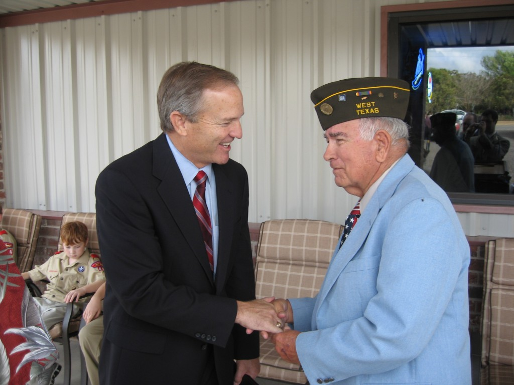 Former Representative Edwards shakes hands with a West, Texas veteran at the dedication of West's VFW post.
